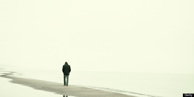 Man walking on beach in winter